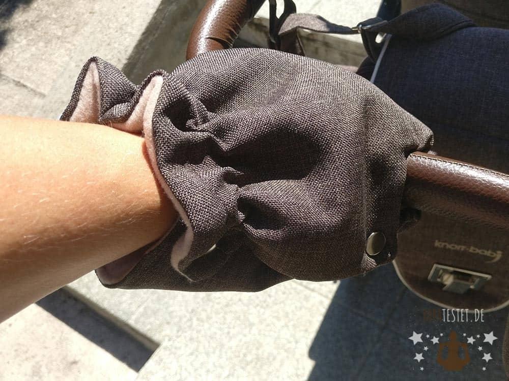 Der Handwärmer für den Griff am Kinderwagen
